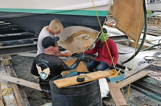 REPAIRS under way on the vessel yesterday.