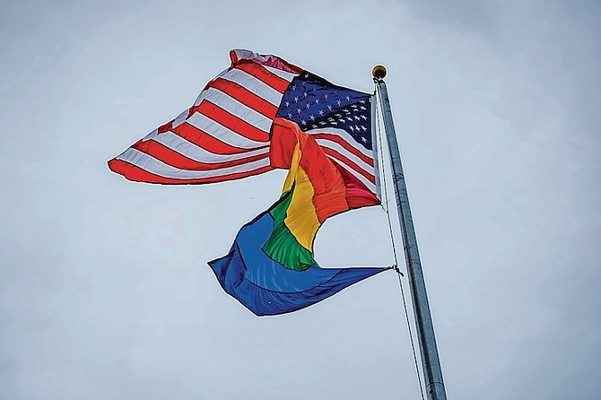 THE PRIDE flag flying alongside the US flag at the US Embassy for Pride Month.