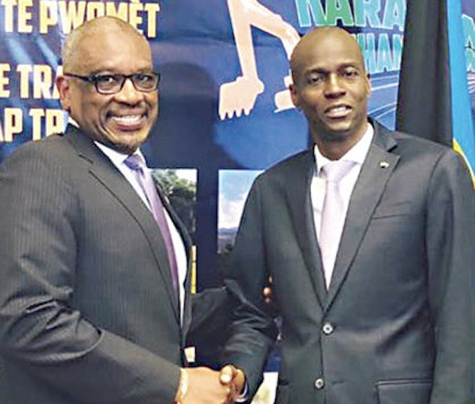 PRIME Minister Dr Hubert Minnis pictured previously with Haiti President Jovenel Moise, who has been assassinated at his home. The Bahamas embassy in Haiti has been ordered closed in the wake of the killing.