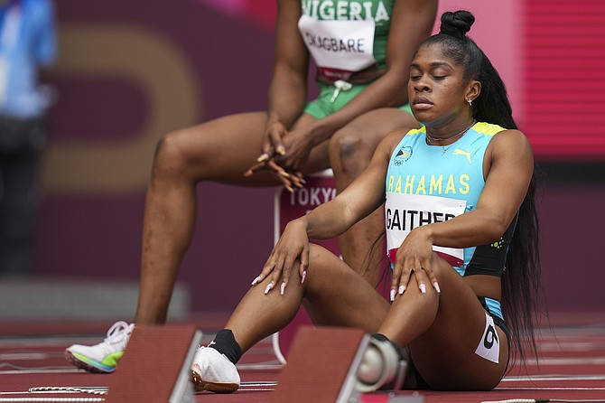 Tynia Gaither waits to start in her heat of the women's 100-metres at the 2020 Summer Olympics, Friday, July 30, 2021, in Tokyo. (AP Photo/Matthias Schrader)