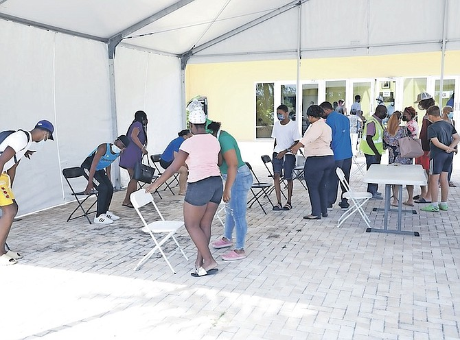 PEOPLE line up for the Pfizer vaccine at Kendal Issacs Gym earlier this month. Photo: Racardo Thomas/Tribune Staff