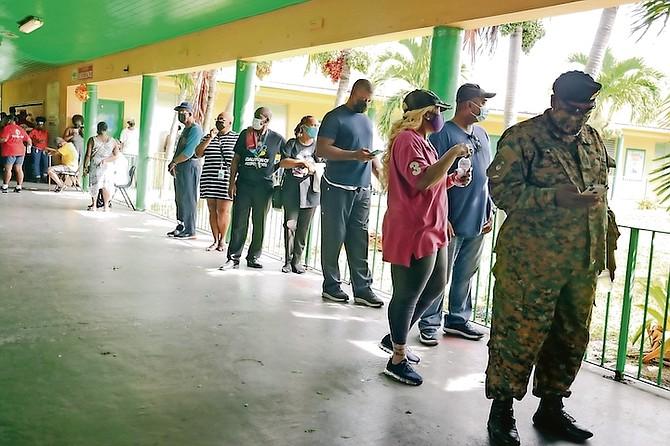 Voters line up at Sadie Curtis Primary School. Photo: Donavan McIntosh/Tribune staff