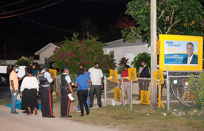 Police at the scene of the stabbing outside the Progressive Liberal Party's Yamacraw constituency office. Photo: Donavan McIntosh/Tribune staff