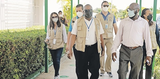 OAS officials visit the Queen's College polling station. Photo: Donovan McIntosh/Tribune Staff