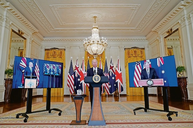 President Joe Biden, joined virtually by Australian Prime Minister Scott Morrison and British Prime Minister Boris Johnson, speaks about the national security initiative from the East Room of the White House in Washington, Wednesday, Sept. 15, 2021.  Photo:Andrew Harnik/AP