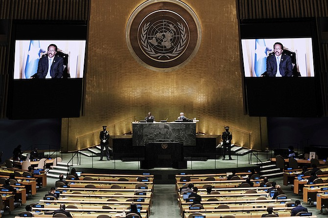 SOMALIA'S President Mohamed Abdullahi Mohamed Farmajo is seen on a video screen as he addresses the 76th Session of the United Nations General Assembly remotely on Tuesday at UN headquarters. Photo: Spencer Platt/AP