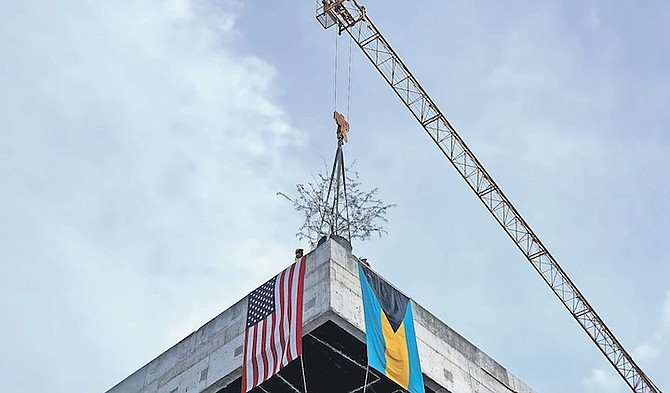 THE MOMENT when the highest point of the US Embassy was topped out on Friday.