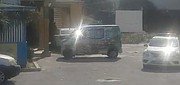 A police car near liquor store premises in a video circulating on social media
